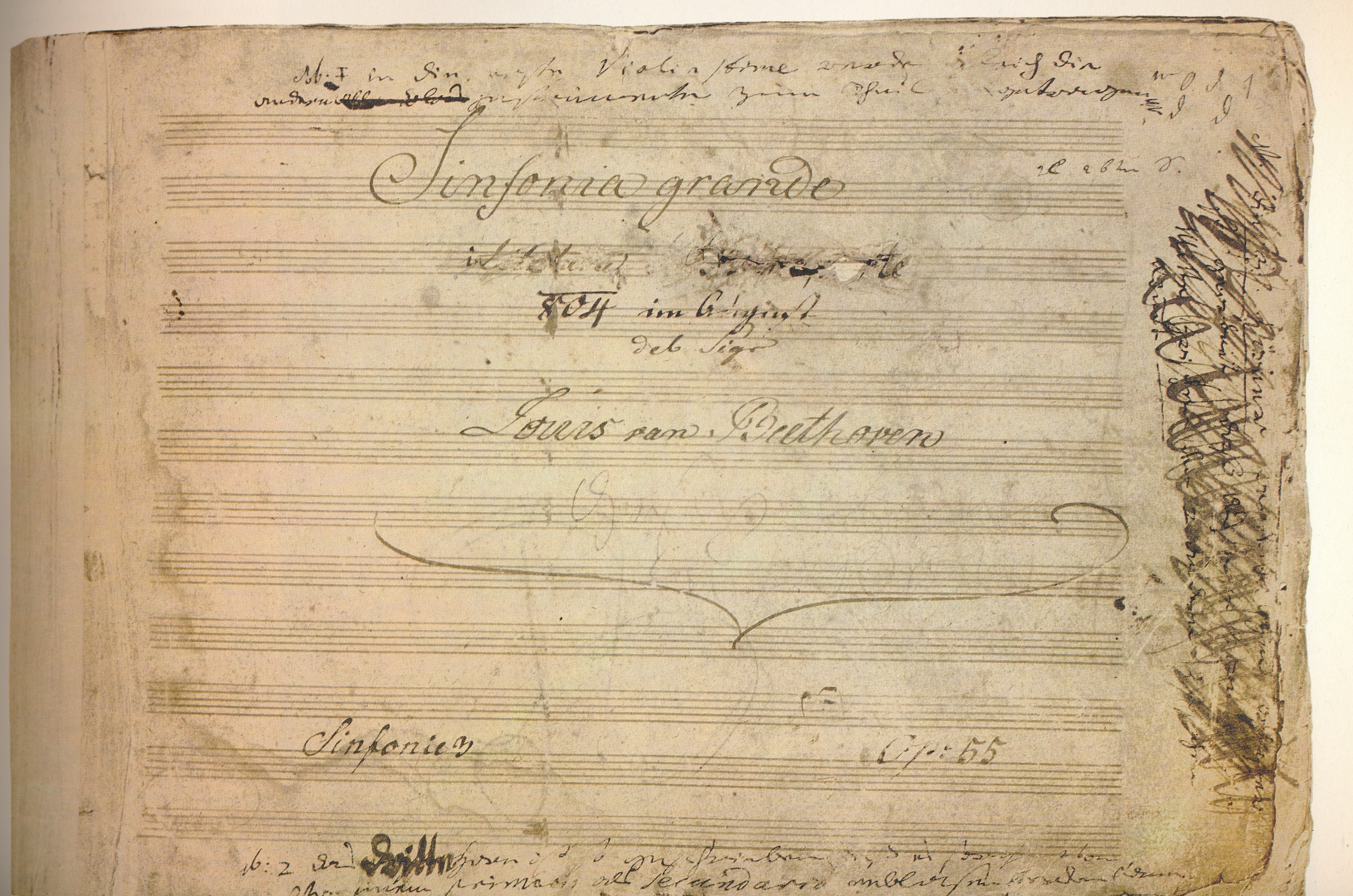 The title page of the manuscript to Beethoven's Third Symphony (the <em>Eroica</em>). The dedication to Napoleon near the top of the symphony has been violently scratched out.