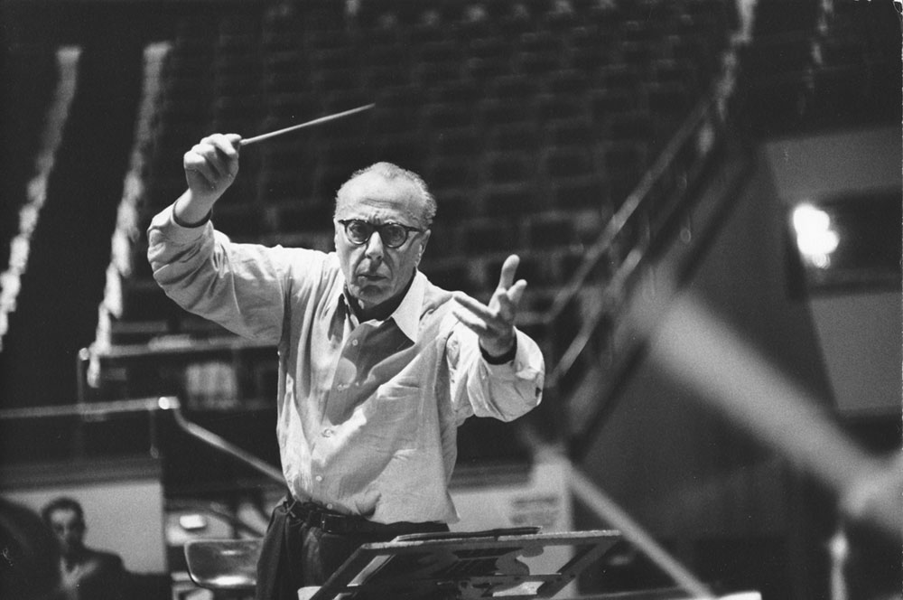 George Szell in a dramatic pose as he conducts the Orchestra.