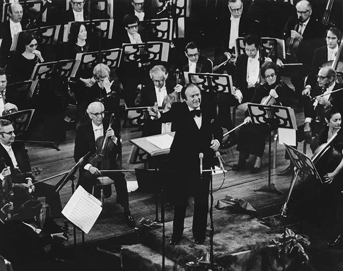 "Robert Page conducting the audience in 1975 ""Sing Messiah!"" concert."