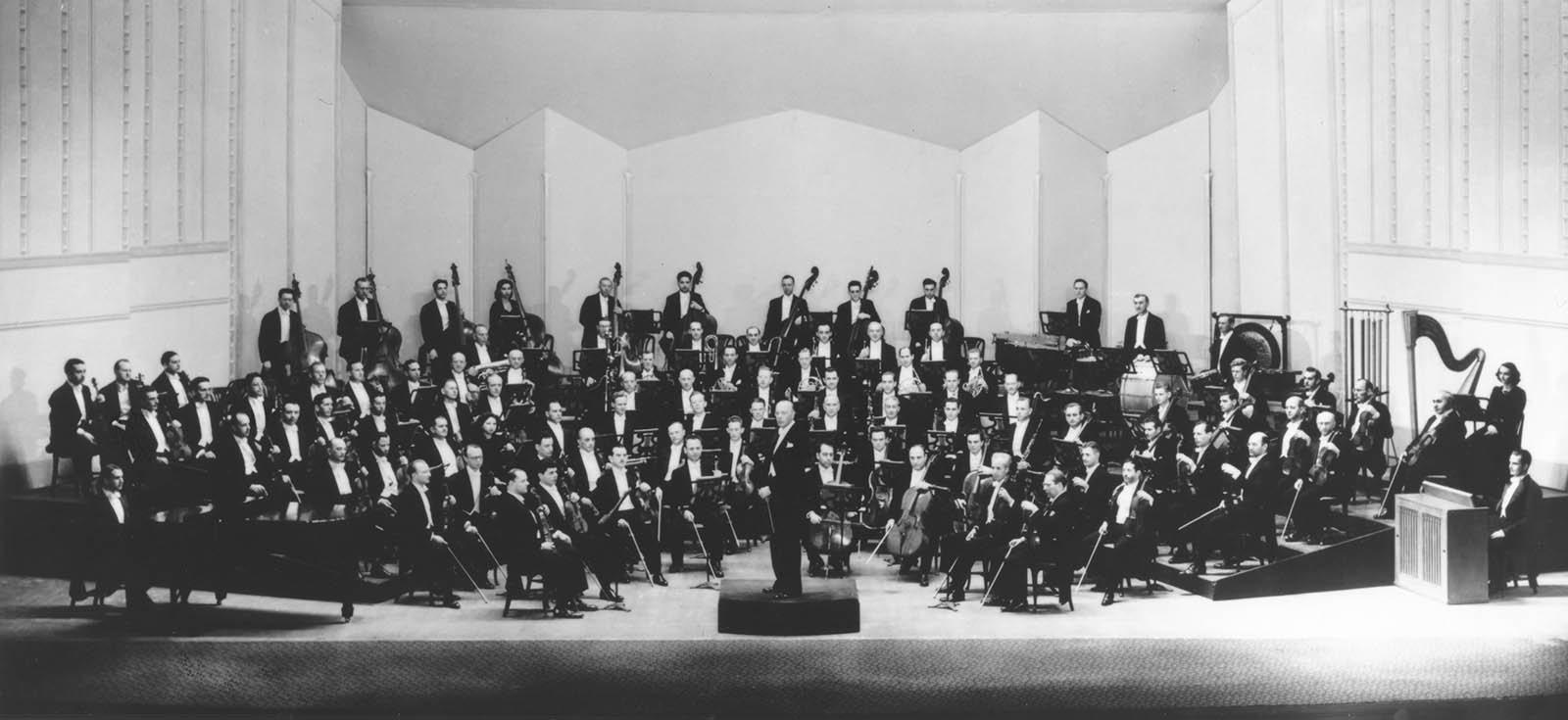 The Cleveland Orchestra and Director George Szell pose in Severance Hall. Unknown photographer, 1946.