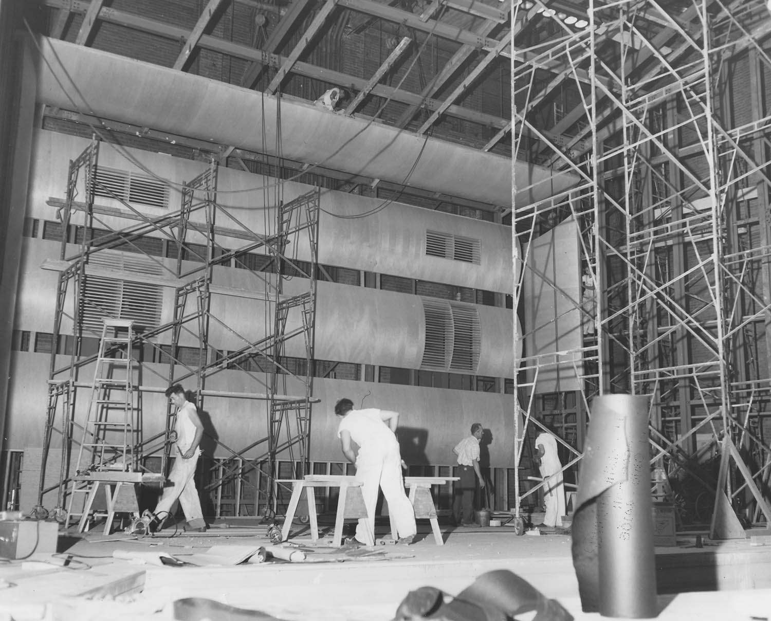 Construction workers on Severance Hall stage during 1958 renovations. Unknown photographer, 1958.