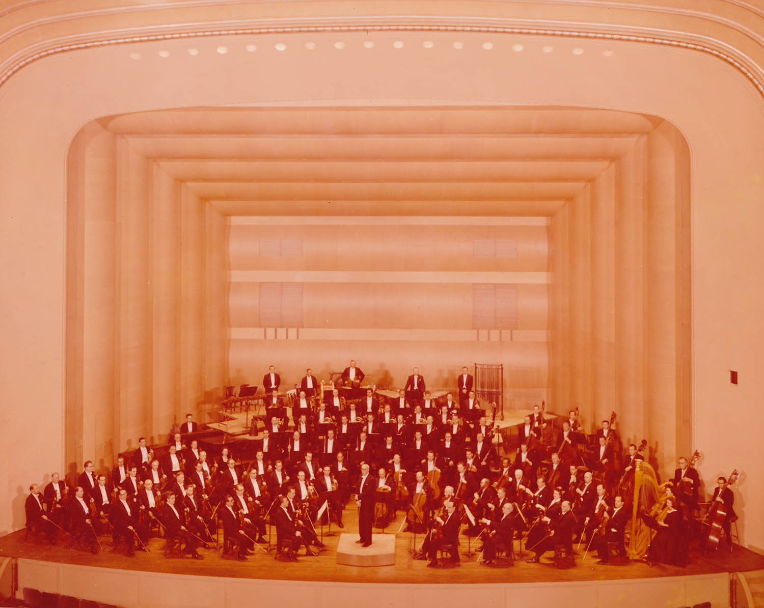 The Cleveland Orchestra and George Szell pose in the newly renovated Concert Hall. Unknown photographer, 1958.