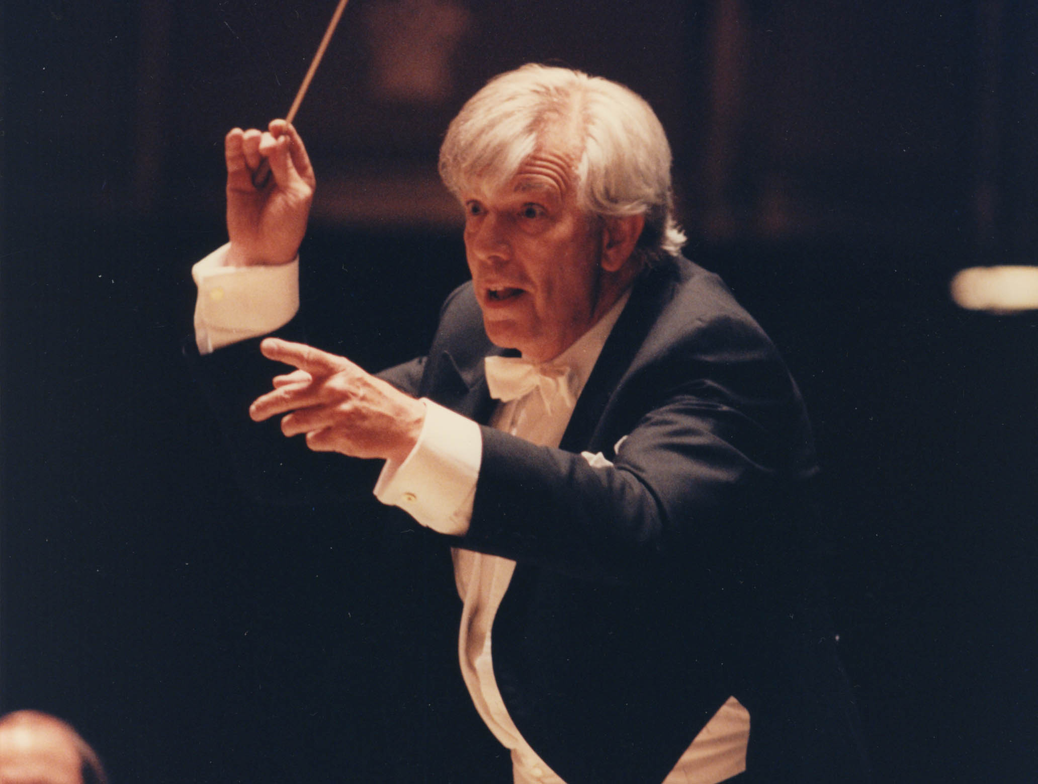Christoph von Dohnányi is conducting. He is very animated, and almost smiling.
