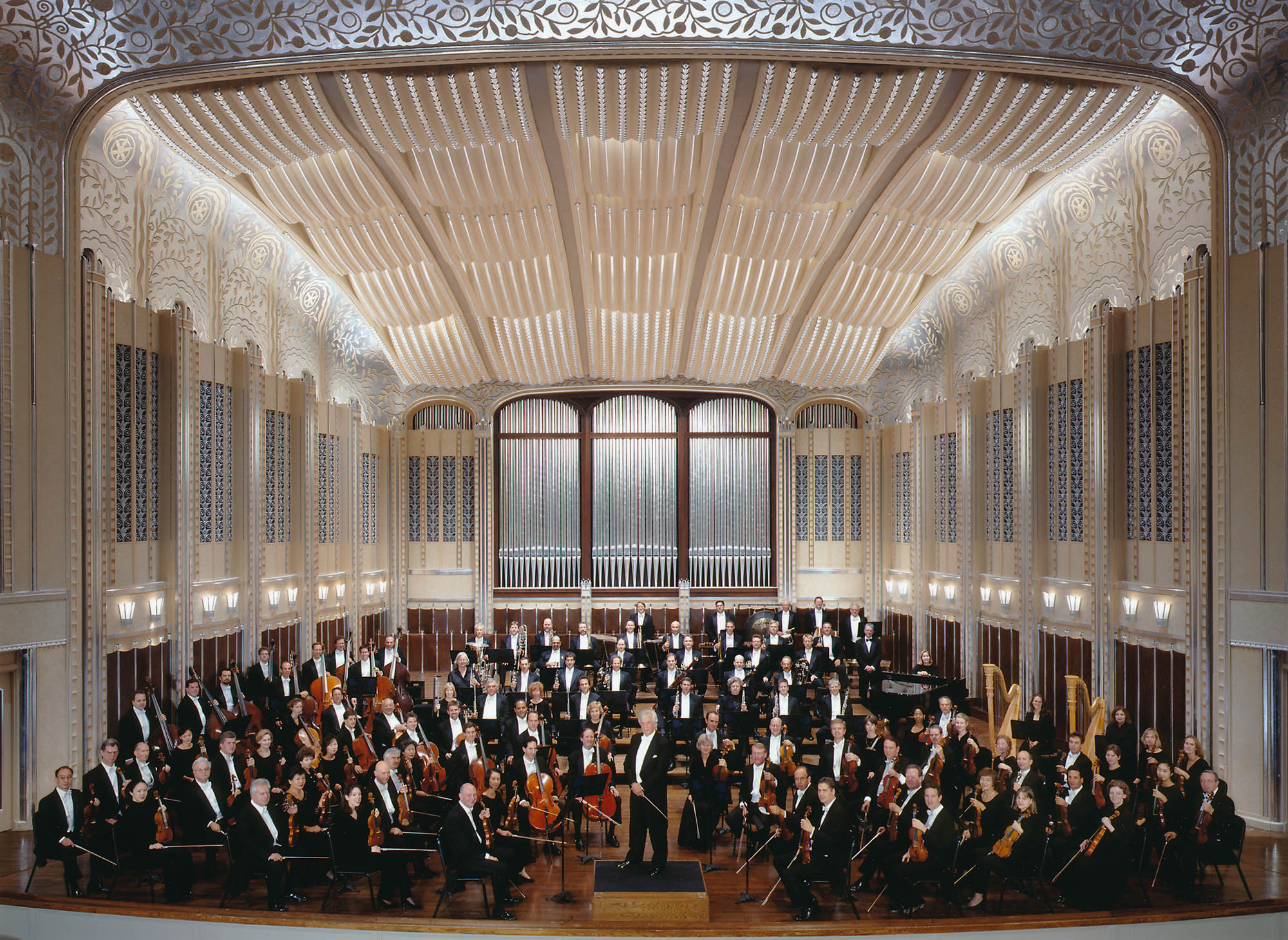 The Orchestra is seated on stage in Severance Hall, with von Dohnányi standing on the podium and looking towards the camera.