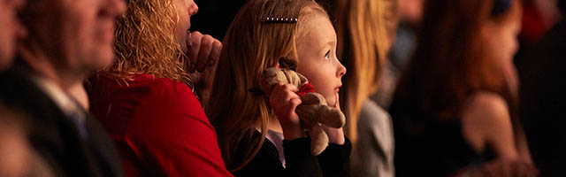 young girl listening to concert music
